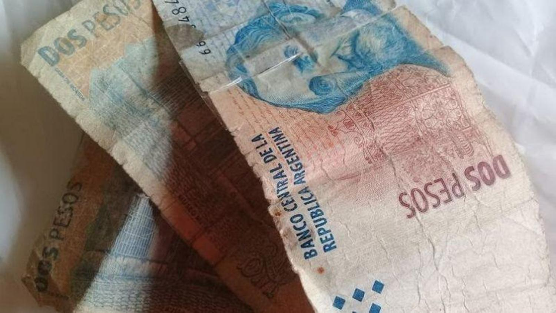 Advierten que comercios están obligados a recibir billetes de 2 pesos