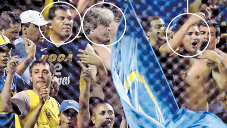 MUY CERCANO. Pereyra, en el círculo de la izquierda, Rafa Di Zeo y Maxi Mazzaro, cuando todo era felicidad en los para avalancha de La Bombonera. FOTO TOMADA DE CLARIN.COM