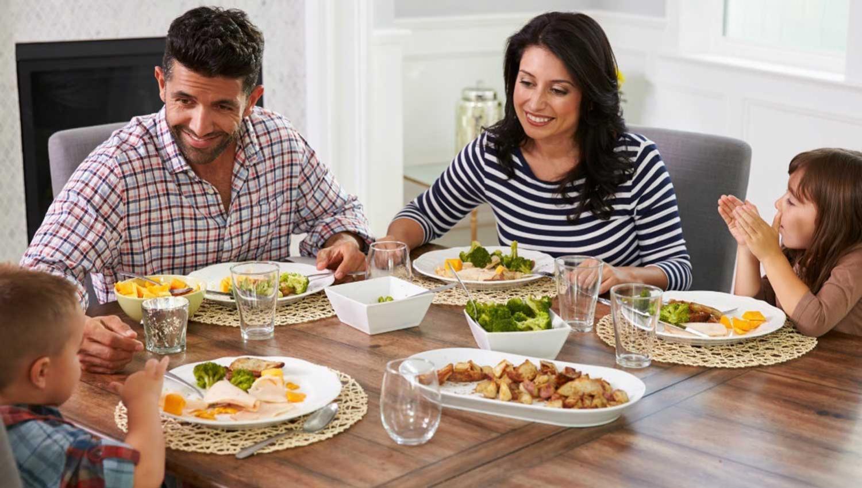 family praying around table - 1200×627